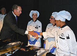 Photo of Chancellor Harris thanking Oxnard College Culinary Arts and Restaurant Management students