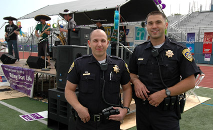 Photo of two officers at campus event