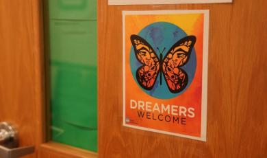 "Sign on a door with a butterfly and the text ""Dreamers"